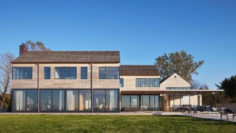 Wheeler Kearns Architects clusters gabled units for Lake Michigan house|惠勒·基恩斯建築事務所為密歇根湖的房屋建造山牆